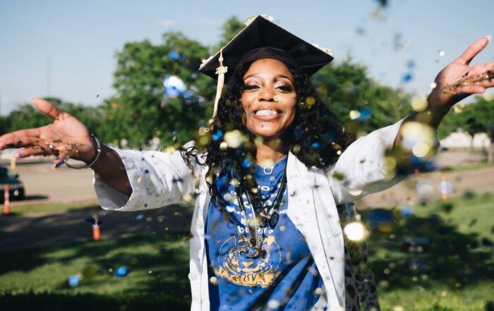 Graduation woman throwing glitter